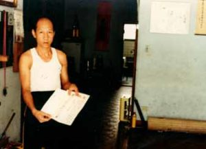 Lo Man Kam with Kai Sai's Teaching Certificate